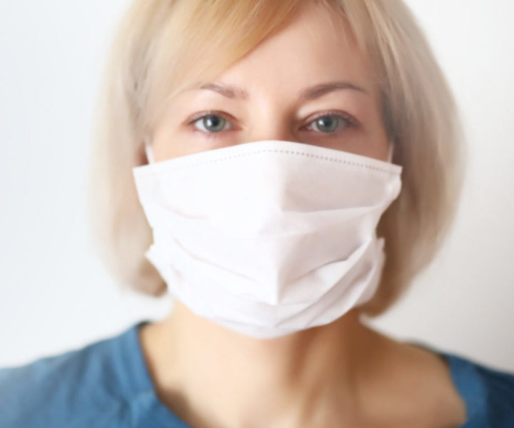 Woman in mask . Protection against virus, infection, exhaust and industrial emissions.